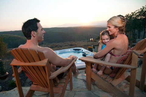 family-at-sunset-hot-tub